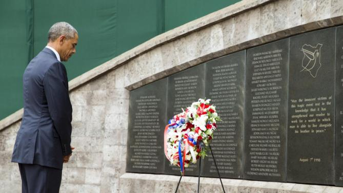 President Barack Obama reflects as he participates in a wreath laying ceremony, Saturday, July 25, 2015, in Nairobi, at Memorial Park in honor of the victims of the deadly 1998 bombing at the U.S. Embassy.  Obama's visit to Kenya is focused on trade and economic issues, as well as security and counterterrorism cooperation.  (AP Photo/Evan Vucci)