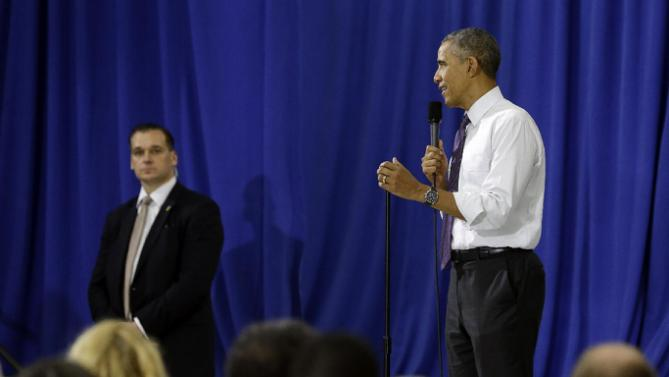 President Barack Obama answers a question from the audience at Taylor Stratton Elementary School in Nashville, Tenn., Wednesday, July 1, 2015, where he spoke about the Affordable Care Act. The president said he wants to refocus on improving health care quality, expanding access and rooting out waste now that the Supreme Court has upheld a key element of his health care law.  (AP Photo/Mark Humphrey)