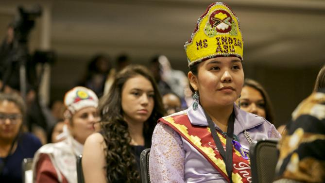 """Brooke Overture, of the Navajo Nation and from Window Rock, Ariz., listens to first lady Michelle Obama speak at the first White House Tribal Youth Gathering, Thursday, July 9, 2015 in Washington.  Michelle Obama on Thursday told hundreds of Native American youth that they are all precious and sacred and that """"each of you was put on this earth for a reason."""" (AP Photo/Jacquelyn Martin)"""