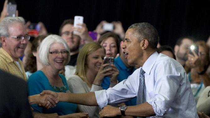 President Barack Obama shakes hands as he arrives to speak at the University of Wisconsin at La Crosse, in La Crosse, Wis., Thursday, July 2, 2015, about the economy and to promote a proposed Labor Department rule that would make more workers eligible for overtime. (AP Photo/Carolyn Kaster)