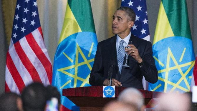 President Barack Obama offers a toast during a state dinner hosted by Ethiopian Prime Minister Hailemariam Desalegn, Monday, July 27, 2015, at the National Palace in Addis Ababa. Obama is the first sitting U.S. president to visit Ethiopia. (AP Photo/Evan Vucci)