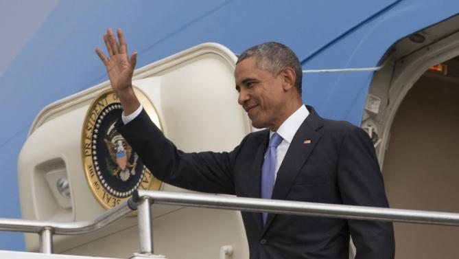 President Barack Obama waves as he arrives at Addis Ababa Bole International Airport, on Sunday, July 26, 2015, in Addis Ababa. Obama is the first sitting U.S. president to visit Ethiopia. (AP Photo/Evan Vucci)