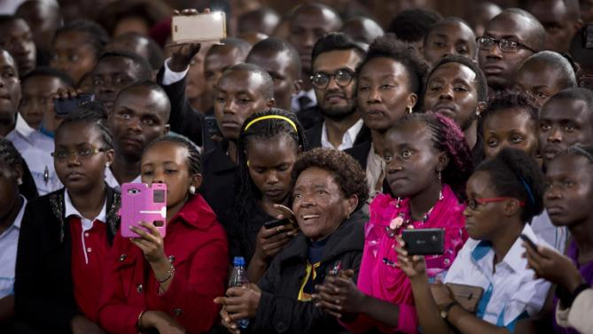 Members of the audience at the front of the crowd listen to President Barack Obama deliver a speech at the Safaricom Indoor Arena in the Kasarani area of Nairobi, Kenya Sunday, July 26, 2015. Obama is traveling on a two-nation African tour where he will become the first sitting U.S. president to visit Kenya and Ethiopia. (AP Photo/Ben Curtis)