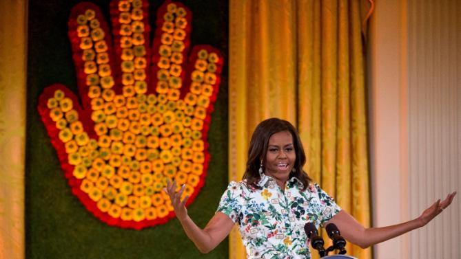 First lady Michelle Obama delivers remarks as she hosts the 2015 winners of the Healthy Lunchtime Challenge for the Kids' State Dinner in the East Room at the White House, Friday, July 10, 2015, in Washington. (AP Photo/Andrew Harnik)