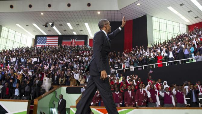 President Barack Obama waves after delivering a speech at Safaricom Indoor Arena, on Sunday, July 26, 2015, in Nairobi. On the final day of his visit in Kenya, Obama laid out his vision for Kenya's future, and broad themes of U.S.-Kenya relations. (AP Photo/Evan Vucci)