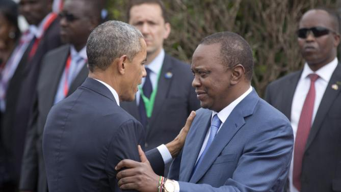 "U.S. President Barack Obama is greeted by Kenya's President Uhuru Kenyatta, right, on his arrival at State House in Nairobi, Kenya, Saturday, July 25, 2015. U.S. President Obama heralded Africa as a continent ""on the move"", as he visits Kenya  Saturday, the East African nation where he has deep family ties.(AP Photo/Ben Curtis)"