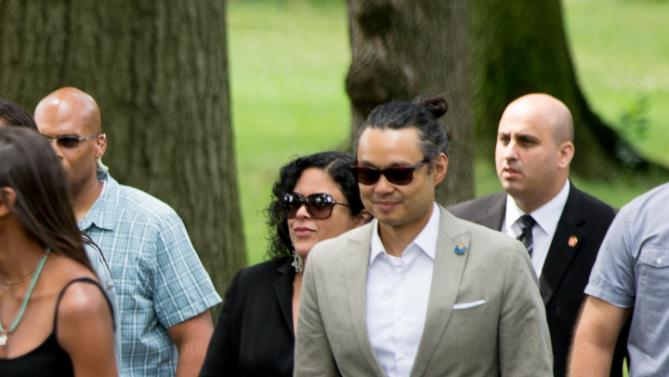 Maya Soetoro-Ng, the sister of President Barack Obama, center left, and her husband Konrad Ngwalk, center right, accompany the president through Central Park, Saturday, July 18, 2015, in New York. Obama is spending a mainly personal weekend with his daughters in New York City. (AP Photo/Andrew Harnik)