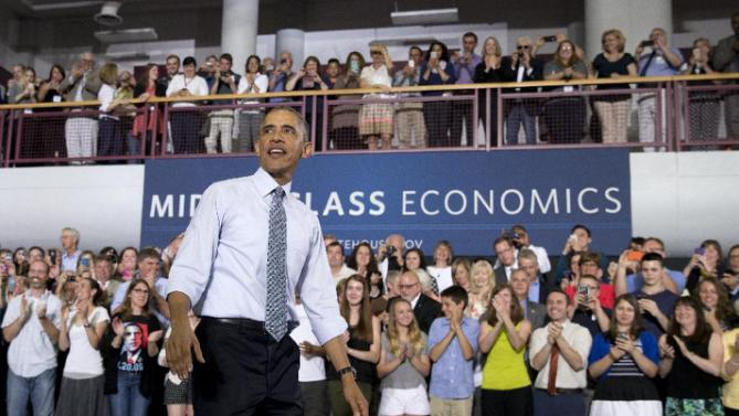 President Barack Obama looks out over the audience after speaking at the University of Wisconsin at La Crosse, in La Crosse, Wisc., Thursday, July 2, 2015, about the economy and to promote a proposed Labor Department rule that would make more workers eligible for overtime. (AP Photo/Carolyn Kaster)