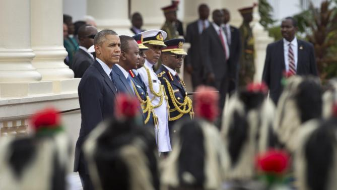 "U.S. President Barack Obama, left, stands next to Kenya's President Uhuru Kenyatta, 2nd left, as the Kenya Air Force military band passes by, at State House in Nairobi, Kenya Saturday, July 25, 2015.  Obama heralded Africa as a continent ""on the move"" while visiting Kenya Saturday, the East African nation where he has deep family ties. (AP Photo/Ben Curtis)"