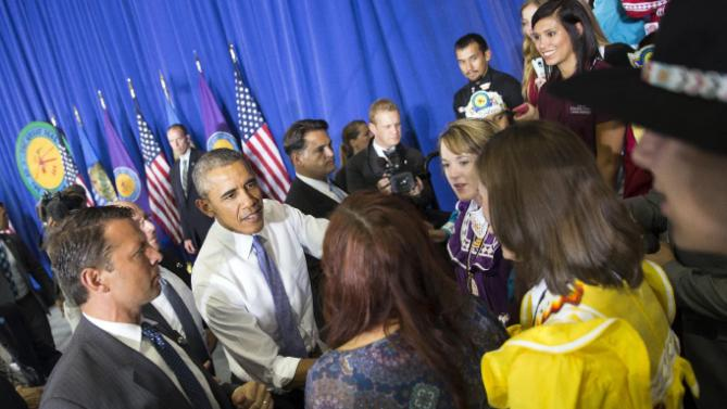 President Barack Obama shakes hands after speaking in the Choctaw Nation on economic opportunities for underprivileged communities across the nation, on Wednesday, July 15, 2015, in Durant, Okla. Obama unveiled a program to bring faster Internet connections to more low-income households, particularly to help students living in public and assisted housing stay ahead in school. (AP Photo/Evan Vucci)