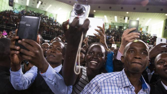 People cheer as President Barack Obama arrives to deliver a speech at Safaricom Indoor Arena, Sunday, July 26, 2015, in Nairobi. On the final day of his visit in Kenya, Obama laid out his vision for Kenya's future, and broad themes of U.S.-Kenya relations. (AP Photo/Evan Vucci)
