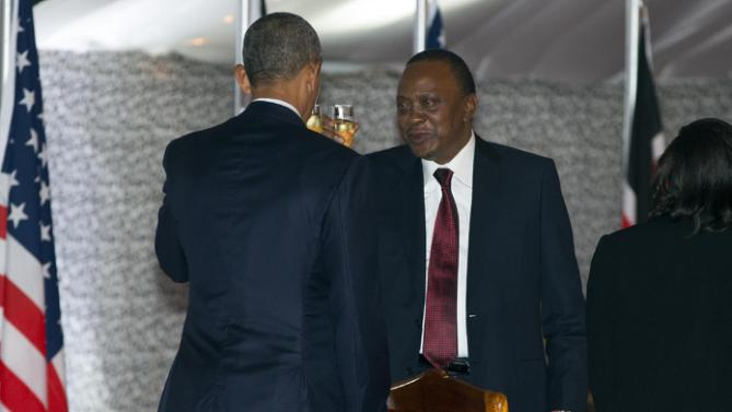 President Barack Obama, left, and Kenyan President Uhuru Kenyatta toast during a state dinner at State House, on Saturday, July 25, 2015, in Nairobi, Kenya. (AP Photo/Evan Vucci)