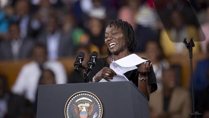 Auma Obama, half-sister of President Barack Obama, introduces him prior to giving a speech at the Safaricom Indoor Arena in the Kasarani area of Nairobi, Kenya Sunday, July 26, 2015. Obama is traveling on a two-nation African tour where he will become the first sitting U.S. president to visit Kenya and Ethiopia. (AP Photo/Ben Curtis)