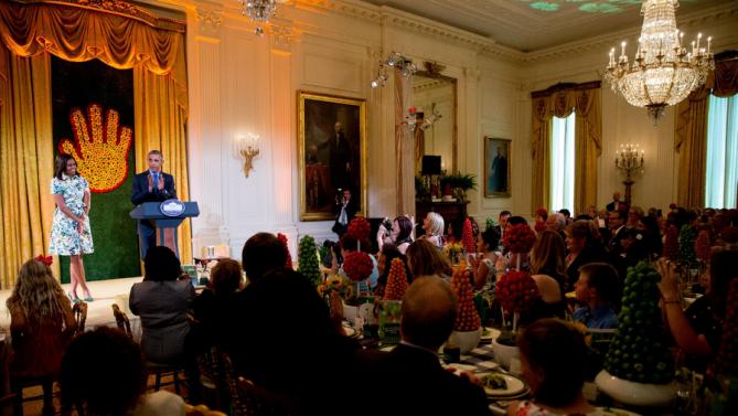 President Barack Obama, accompanied by first lady Michelle Obama, delivers remarks as he makes an unannounced appearance at the Kids' State Dinner in the East Room at the White House, Friday, July 10, 2015, in Washington. The children present were part of the 2015 winners of the Healthy Lunchtime Challenge. (AP Photo/Andrew Harnik)