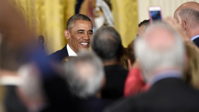 President Barack Obama shakes hands with guests after speaking at the at the 2015 White House Conference, Monday, July 13, 2015, on Aging in the East Room of the White House in Washington. (AP Photo/Susan Walsh)
