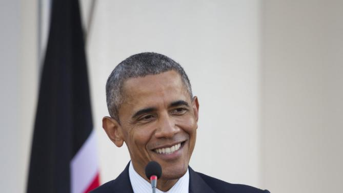 "U.S. President Barack Obama makes a joke while answering a question from the media about the dinner he had with his Kenyan relatives, after meeting with Kenya's President Uhuru Kenyatta, at State House in Nairobi, Kenya Saturday, July 25, 2015. Obama heralded Africa as a continent ""on the move"", as he visits Kenya  Saturday, the East African nation where he has deep family ties. (AP Photo/Ben Curtis)"