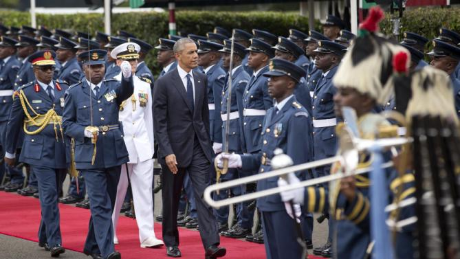 "U.S. President Barack Obama inspects the honor guard after arriving to meet with Kenya's President Uhuru Kenyatta at State House in Nairobi, Kenya, Saturday, July 25, 2015. U.S. President Obama heralded Africa as a continent ""on the move"", as he visits Kenya  Saturday, the East African nation where he has deep family ties. (AP Photo/Ben Curtis)"