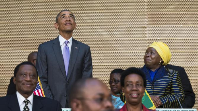 African Union Commission chairperson, Dr. Nkosazana Dlamini-Zuma, right, stands with U.S. President Barack Obama as he looks up at the crowd before delivering a speech to the African Union, Tuesday, July 28, 2015, in Addis Ababa, Ethiopia. On the final day of his African trip, Obama is focusing on economic opportunities and African security. (AP Photo/Evan Vucci)