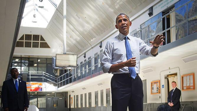 US President Barack Obama speaks as he tours the El Reno Federal Correctional Institution in El Reno, Oklahoma, July 16, 2015. Obama is the first sitting US President to visit a federal prison, in a push to reform one of the most expensive and crowded prison systems in the world. AFP PHOTO / SAUL LOEB        (Photo credit should read SAUL LOEB/AFP/Getty Images)