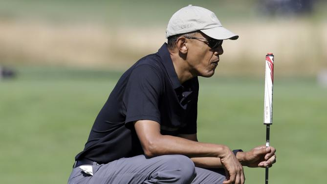 President Barack Obama golfs Monday, Aug. 10, 2015, at Vineyard Golf Club, in Edgartown, Mass., on the island of Martha's Vineyard. The president is staying on Martha's Vineyard with first lady Michelle Obama and daughter Sasha for a 17-day island retreat. (AP Photo/Steven Senne)