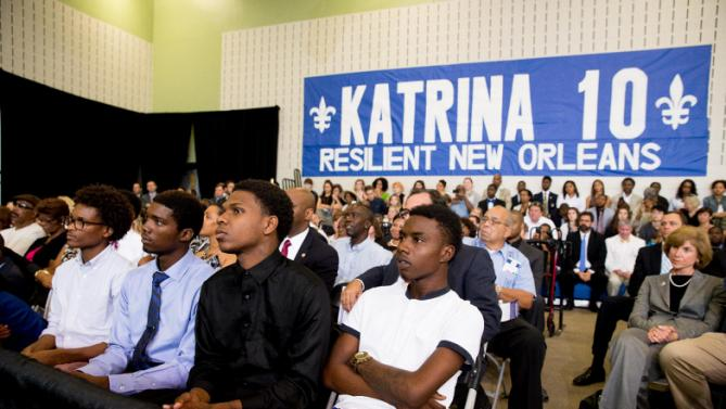Four young men who's lives were affected by Hurricane Katrina listen as President Barack Obama delivers remarks at Andrew P. Sanchez Community Center in New Orleans, Thursday, Aug. 27, 2015, for the 10th anniversary since the devastation of Hurricane Katrina. The young men had lunch with the president and discussed resiliency in the face of adversity. (AP Photo/Andrew Harnik)