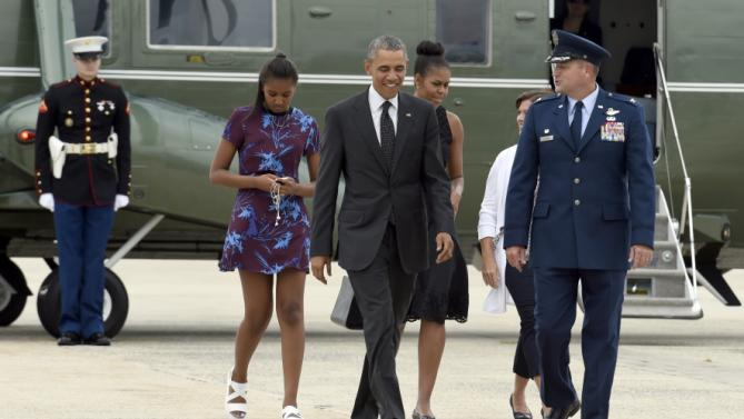 President Barack Obama, first lady Michelle Obama and daughter Sasha walk off of Marine One and head towards Air Force One at Andrews Air Force Base, Md., Friday, Aug. 7, 2015. The president will return to his summer vacation spot of choice, the Massachusetts island of Martha's Vineyard, a day earlier than originally planned for more than two weeks of hoped-for rest coupled with extended pursuit of his favorite leisure sport: golf. (AP Photo/Susan Walsh)