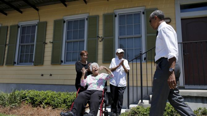 "U.S. President Barack Obama is welcomed by local residents of an area reconstructed after Hurricane Katrina during a presidential visit to New Orleans, Louisiana, August 27, 2015. Obama on Thursday will highlight the ""structural inequality"" that hurt poor black people in New Orleans before the devastation of Hurricane Katrina, during a visit to celebrate the city's progress 10 years after the storm. REUTERS/Carlos Barria"