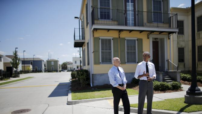 "U.S. President Barack Obama delivers remarks during a visit to an area reconstructed after Hurricane Katrina, accompanied by New Orleans mayor Mitch Landrieu (L), during a presidential visit to New Orleans, Louisiana, August 27, 2015. Obama on Thursday will highlight the ""structural inequality"" that hurt poor black people in New Orleans before the devastation of Hurricane Katrina, during a visit to celebrate the city's progress 10 years after the storm. REUTERS/Carlos Barria"