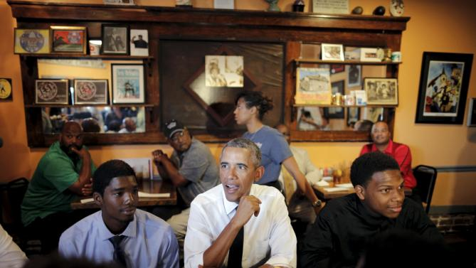 "U.S. President Barack Obama sits for lunch at Willie Mae's restaurant near downtown during a presidential visit to New Orleans, Louisiana, August 27, 2015. Obama on Thursday will highlight the ""structural inequality"" that hurt poor black people in New Orleans before the devastation of Hurricane Katrina, during a visit to celebrate the city's progress 10 years after the storm. REUTERS/Carlos Barria TPX IMAGES OF THE DAY"