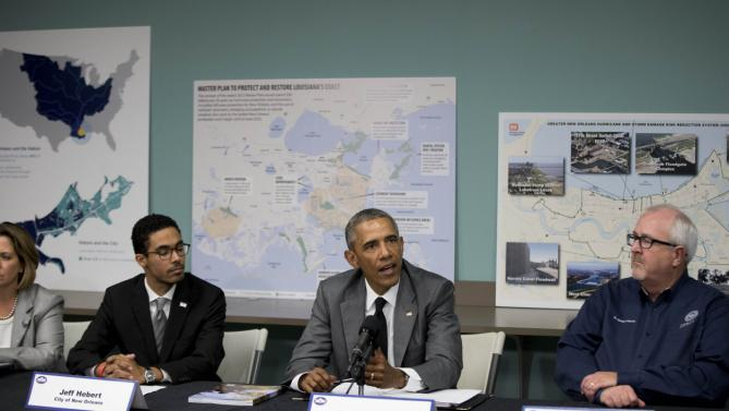 President Barack Obama participates in a roundtable on Hurricane Katrina at the Andrew P. Sanchez Community Center in New Orleans, Thursday, Aug. 27, 2015, while visiting for the 10th anniversary since the devastation of Hurricane Katrina. The roundtable highlighted advancements in national preparedness, showcase Gulf Coast resiliency, mark the achievements of the New Orleans community over the past 10 years with opportunities to build future resilience.(AP Photo/Andrew Harnik)