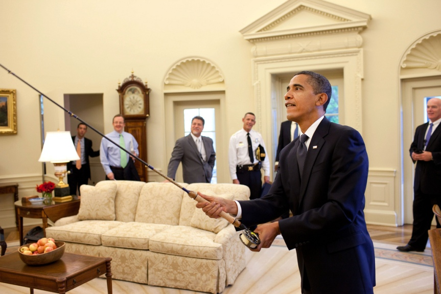 President Barack Obama tries out the fly fishing rod given to him on his birthday by a group of avid fisherman on his staff, August 4, 2009. (Official White House Photo by Pete Souza) This official White House photograph is being made available only for publication by news organizations and/or for personal use printing by the subject(s) of the photograph. The photograph may not be manipulated in any way and may not be used in commercial or political materials, advertisements, emails, products, promotions that in any way suggests approval or endorsement of the President, the First Family, or the White House.