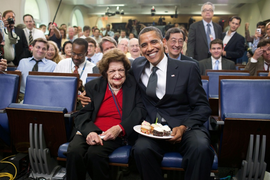 President Barack Obama presents cupcakes with a candle to Hearst White House columnist Helen Thomas in honor of her birthday in the James Brady Briefing Room, August 4, 2009. Thomas, who turned 89 , shares the same birthday as Obama, who turne 48 years old. (Official White House Photo by Pete Souza) This official White House photograph is being made available only for publication by news organizations and/or for personal use printing by the subject(s) of the photograph. The photograph may not be manipulated in any way and may not be used in commercial or political materials, advertisements, emails, products, promotions that in any way suggests approval or endorsement of the President, the First Family, or the White House.