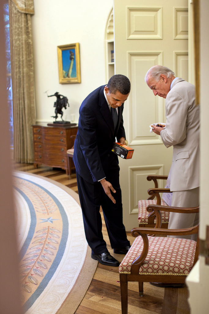 President Barack Obama points out cake crumbs on the floor to Vice President Joe Biden following a birthday celebration in Oval Office,  August 4, 2009. (Official White House Photo by Pete Souza) This official White House photograph is being made available only for publication by news organizations and/or for personal use printing by the subject(s) of the photograph. The photograph may not be manipulated in any way and may not be used in commercial or political materials, advertisements, emails, products, promotions that in any way suggests approval or endorsement of the President, the First Family, or the White House.