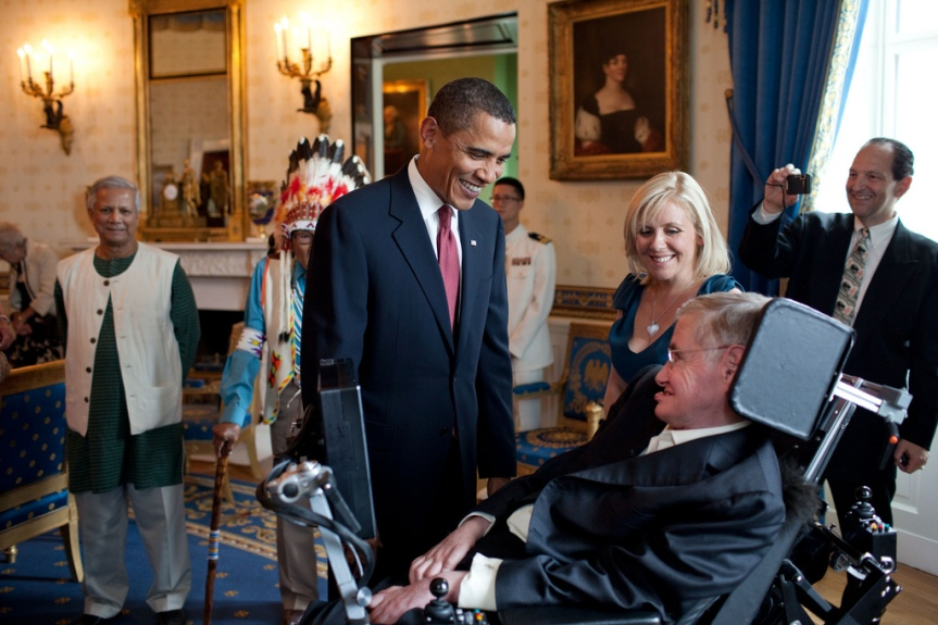 President Barack Obama talks with Stephen Hawking in the Blue Room of the White House before a ceremony presenting him and 15 others the Presidential Medal of Freedom, August 12, 2009. The Medal of Freedom is the nation's highest civilian honor. (Official White House photo by Pete Souza) This official White House photograph is being made available only for publication by news organizations and/or for personal use printing by the subject(s) of the photograph. The photograph may not be manipulated in any way and may not be used in commercial or political materials, advertisements, emails, products, promotions that in any way suggests approval or endorsement of the President, the First Family, or the White House.