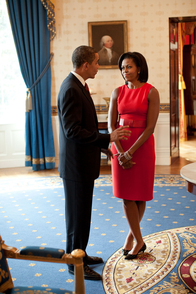 President Barack Obama and First Lady Michelle Obama talk in the Blue Room of the White House before the start of the Presidential Medal of Freedom ceremony, August 12, 2009. (Official White House photo by Pete Souza) This official White House photograph is being made available only for publication by news organizations and/or for personal use printing by the subject(s) of the photograph. The photograph may not be manipulated in any way and may not be used in commercial or political materials, advertisements, emails, products, promotions that in any way suggests approval or endorsement of the President, the First Family, or the White House.