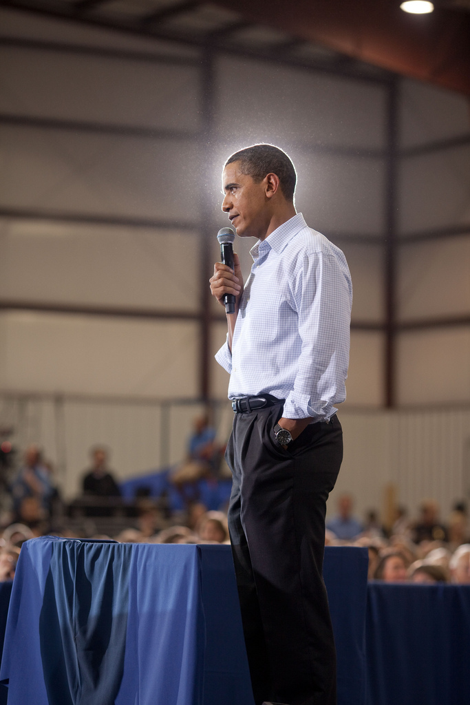 President Barack Obama addresses a town hall meeting on health care insurance reform inside a hangar at Gallatin Field in Belgrade, Montana, August 14, 2009. (Official White House photo by Pete Souza) This official White House photograph is being made available only for publication by news organizations and/or for personal use printing by the subject(s) of the photograph. The photograph may not be manipulated in any way and may not be used in commercial or political materials, advertisements, emails, products, promotions that in any way suggests approval or endorsement of the President, the First Family, or the White House.