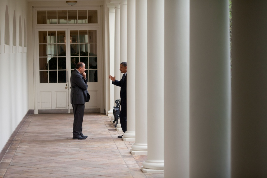 President Barack Obama talks with Senior Advisor David Alexrod on the Colonnade of the White House, August 13, 2009. (Official White House Photo by Pete Souza) This official White House photograph is being made available only for publication by news organizations and/or for personal use printing by the subject(s) of the photograph. The photograph may not be manipulated in any way and may not be used in commercial or political materials, advertisements, emails, products, promotions that in any way suggests approval or endorsement of the President, the First Family, or the White House.
