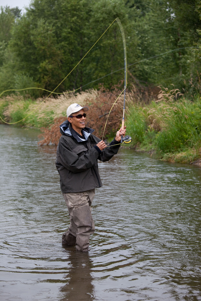President Barack Obama casts his line while fishing for trout on the East Gallatin River near Belgrade, Mont., August 14, 2009. The President hooked about 6 fish, but did not land any during his first fly fishing outing. (Official White House photo by Pete Souza) This official White House photograph is being made available only for publication by news organizations and/or for personal use printing by the subject(s) of the photograph. The photograph may not be manipulated in any way and may not be used in commercial or political materials, advertisements, emails, products, promotions that in any way suggests approval or endorsement of the President, the First Family, or the White House.