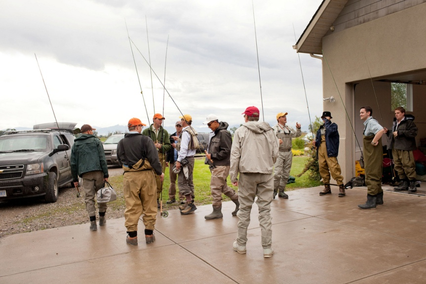 President Barack Obama, center, and his fishing party head for the water during his first fly fishing outing near Belgrade, Mont., August 14, 2009. (Official White House photo by Pete Souza) This official White House photograph is being made available only for publication by news organizations and/or for personal use printing by the subject(s) of the photograph. The photograph may not be manipulated in any way and may not be used in commercial or political materials, advertisements, emails, products, promotions that in any way suggests approval or endorsement of the President, the First Family, or the White House.