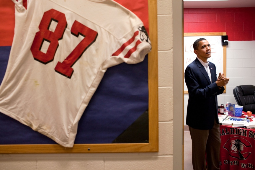 President Barack Obama prepares to autographs books and photographs in a backstage holding room following a town hall meeting on health care insurance reform at Central High School in Grand Junction, Colorado on Aug. 15, 2009. (Official White House photo by Pete Souza) This official White House photograph is being made available only for publication by news organizations and/or for personal use printing by the subject(s) of the photograph. The photograph may not be manipulated in any way and may not be used in commercial or political materials, advertisements, emails, products, promotions that in any way suggests approval or endorsement of the President, the First Family, or the White House.