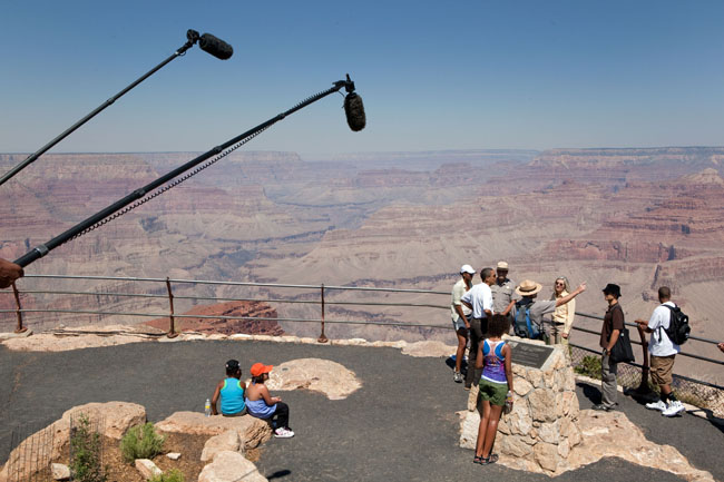 Television microphones hang in the air as the media listens in while a Park Ranger explains the site to President Barack Obama and family during a tour of the Grand Canyon, August 16, 2009. (Official White House photo by Pete Souza) This official White House photograph is being made available only for publication by news organizations and/or for personal use printing by the subject(s) of the photograph. The photograph may not be manipulated in any way and may not be used in commercial or political materials, advertisements, emails, products, promotions that in any way suggests approval or endorsement of the President, the First Family, or the White House.
