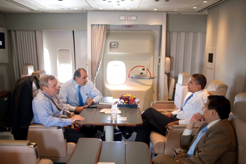 President Barack Obama talks with Senior Advisor David Alexrod and Se. Dick Durbin, (D-Ill.), on Air Force One en route to Portsmouth, N.H. for a town hall meeting about health care reform August 11, 2009.  (Official White House photo by Pete Souza) This official White House photograph is being made available only for publication by news organizations and/or for personal use printing by the subject(s) of the photograph. The photograph may not be manipulated in any way and may not be used in commercial or political materials, advertisements, emails, products, promotions that in any way suggests approval or endorsement of the President, the First Family, or the White House.