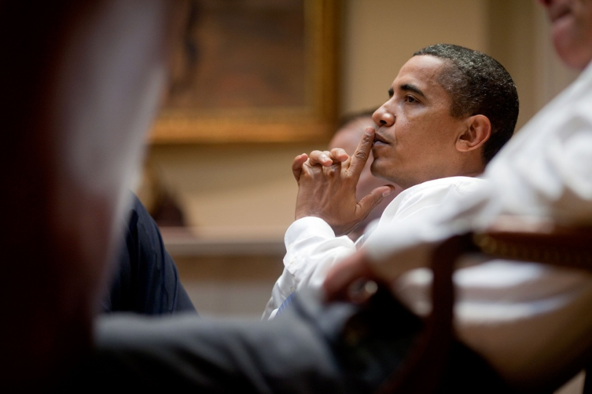 President Barack Obama attends a health care meeting in the Roosevelt Room of the White House,  August 7, 2009.    (Official White House Photo by Pete Souza) This official White House photograph is being made available only for publication by news organizations and/or for personal use printing by the subject(s) of the photograph. The photograph may not be manipulated in any way and may not be used in commercial or political materials, advertisements, emails, products, promotions that in any way suggests approval or endorsement of the President, the First Family, or the White House.