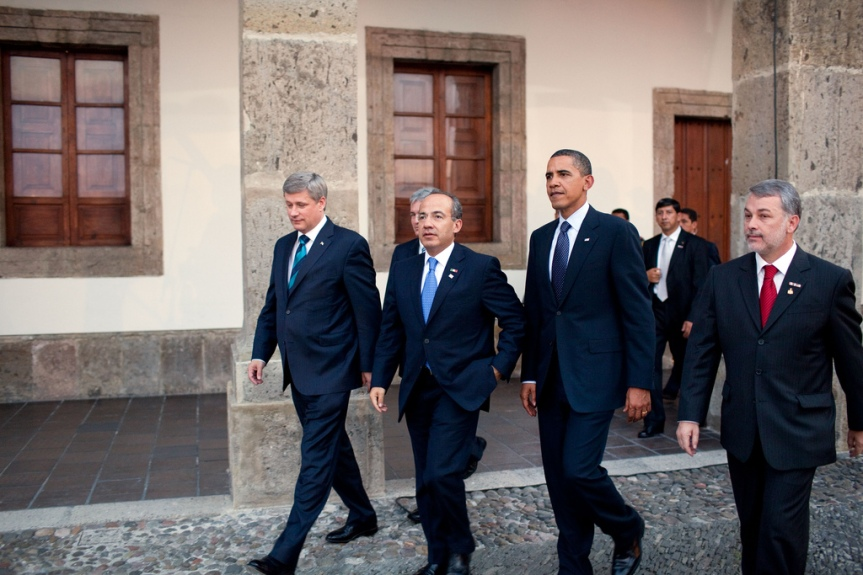 President Barack Obama, Canada's Prime Minister Stephen Harper, left, Mexico's President Felipe Calderon, second from left, and  governor Emilio Gonzalez, right, walk across the main courtyard at the the Cabanas Cultural Center during the North American Leaders' Summit in Guadalajara, Mexico, August 10, 2009.  (Official White House Photo by Pete Souza) This official White House photograph is being made available only for publication by news organizations and/or for personal use printing by the subject(s) of the photograph. The photograph may not be manipulated in any way and may not be used in commercial or political materials, advertisements, emails, products, promotions that in any way suggests approval or endorsement of the President, the First Family, or the White House.