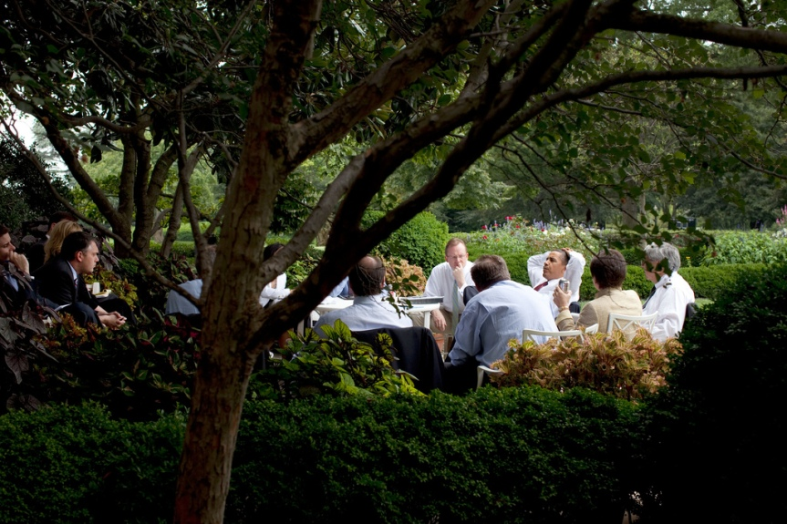 President Barack Obama and his senior advisors meet in the Rose Garden, taking advantage of a pleasant summer day in Washington, August 12, 2009. (Official White House photo by Pete Souza) This official White House photograph is being made available only for publication by news organizations and/or for personal use printing by the subject(s) of the photograph. The photograph may not be manipulated in any way and may not be used in commercial or political materials, advertisements, emails, products, promotions that in any way suggests approval or endorsement of the President, the First Family, or the White House.