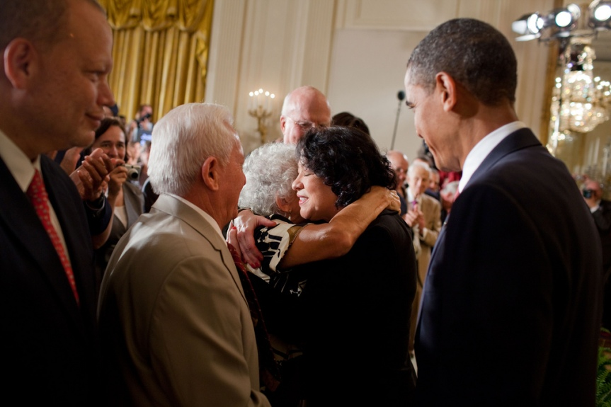 President Barack Obama looks on as Justice Sonia Sotomayor hugs her mother Celina at the end of a reception for the new Supreme Court Justice in the East Room of the White House, August 12, 2009. (Official White House Photo by Pete Souza) This official White House photograph is being made available only for publication by news organizations and/or for personal use printing by the subject(s) of the photograph. The photograph may not be manipulated in any way and may not be used in commercial or political materials, advertisements, emails, products, promotions that in any way suggests approval or endorsement of the President, the First Family, or the White House.