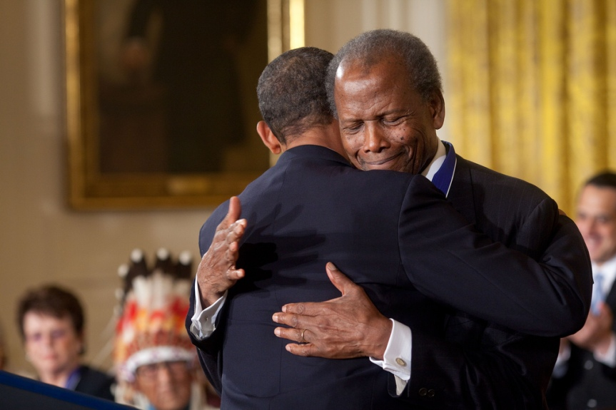 President Barack Obama hugs Presidential Medal of Freedom recipient actor Sidney Poitier during the award ceremony in the East Room of the White House, August 12, 2009. (Official White House photo by Pete Souza) This official White House photograph is being made available only for publication by news organizations and/or for personal use printing by the subject(s) of the photograph. The photograph may not be manipulated in any way and may not be used in commercial or political materials, advertisements, emails, products, promotions that in any way suggests approval or endorsement of the President, the First Family, or the White House.