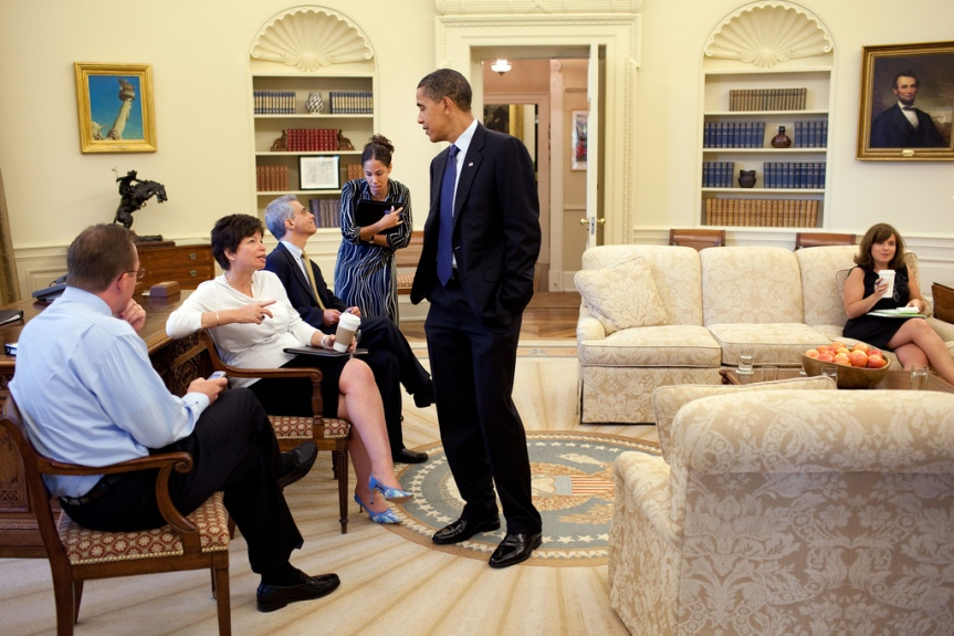 President Barack Obama Oval Office listens to Valerie Jarrett during a meeting with senior staff in the Oval Office August 13, 2009. From left; White House Press Secretary Robert Gibbs, Jarrett, White House Chief of Staff Rahm Emanuel, and Assistant to the President Mona Sutphen. Seated at far right is Alyssa Mastromonaco, Director of Scheduling. (Official White House photo by Pete Souza) This official White House photograph is being made available only for publication by news organizations and/or for personal use printing by the subject(s) of the photograph. The photograph may not be manipulated in any way and may not be used in commercial or political materials, advertisements, emails, products, promotions that in any way suggests approval or endorsement of the President, the First Family, or the White House.