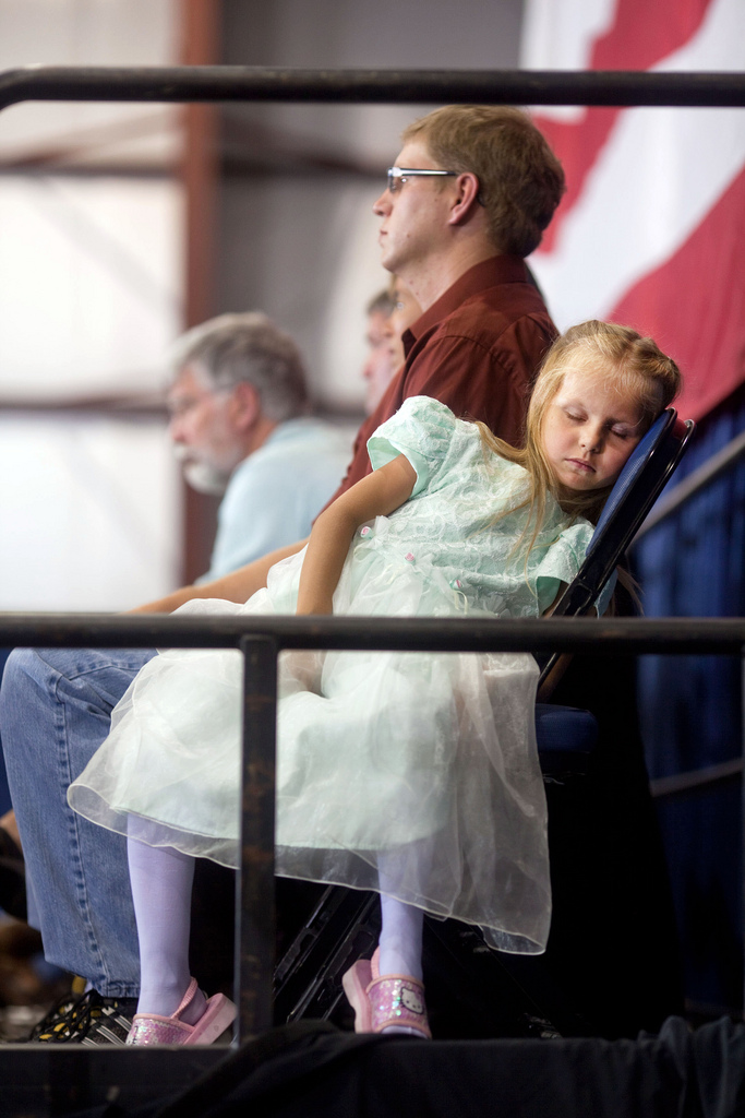 A young girl in the audience sleeps in her chair as President Barack Obama addresses a town hall meeting on health care insurance reform inside a hangar at Gallatin Field in Belgrade, Montana, August 14, 2009.(Official White House photo by Pete Souza) This official White House photograph is being made available only for publication by news organizations and/or for personal use printing by the subject(s) of the photograph. The photograph may not be manipulated in any way and may not be used in commercial or political materials, advertisements, emails, products, promotions that in any way suggests approval or endorsement of the President, the First Family, or the White House.