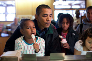 President Barack Obama and daughter Sasha look over the different flavors of ice cream available at a store during their visit to Yellowstone National Park, August 15, 2009. Daughter Malia, in background, has already made her selection. (Official White House photo by Pete Souza) This official White House photograph is being made available only for publication by news organizations and/or for personal use printing by the subject(s) of the photograph. The photograph may not be manipulated in any way and may not be used in commercial or political materials, advertisements, emails, products, promotions that in any way suggests approval or endorsement of the President, the First Family, or the White House.
